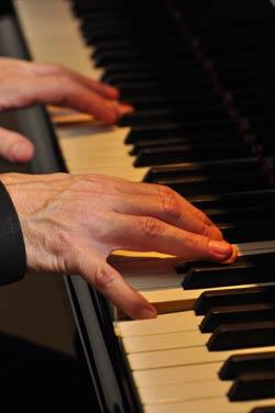 Corey McVicar playing piano